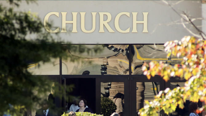 Church members leave the main sanctuary building at World Changers Church International in College Park, Ga. on Wednesday, Oct. 24, 2012, next door to the chapel where a church volunteer leading prayer was shot and killed. Authorities were searching for former church employee Floyd Palmer, who is suspected in the shooting. (AP Photo/Atlanta Journal-Constitution, John Spink)  MARIETTA DAILY OUT; GWINNETT DAILY POST OUT; LOCAL TV OUT; WXIA-TV OUT; WGCL-TV OUT
