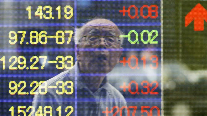 A man is reflected on the electronic board of a securities firm in Tokyo, Monday, June 10, 2013. Asian markets rose Monday after U.S. jobs data helped allay concern the Fed might wind down its stimulus and Japan's prime minister promised new tax cuts. Tokyo's Nikkei 225, the regional heavyweight, jumped 2.8 percent to 13,245 while Hong Kong's Hang Seng Index added just under 0.1 percent to 21,589.0. (AP Photo/Koji Sasahara)