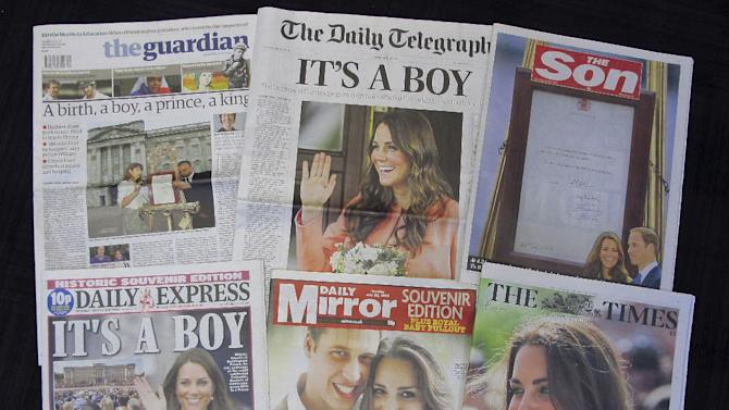 A selection of British daily newspapers on Tuesday July 23, 2013 headlining the news of the birth of a son to Prince William and Kate, the Duke and Duchess of Cambridge. It was announced on Monday that Prince William's wife Kate has given birth to a baby boy. The baby was born at 4:24 p.m. and weighs 8 pounds 6 ounces. The infant will become third in line for the British throne after Prince Charles and William. (AP Photo/Tony Hicks)