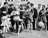 American actress Marilyn Monroe kicks the soccer ball during a game pitting Israel&#39;s Hapoel club against the All-Stars US team at the Ebbets Field stadium in Brooklyn in 1957. August 5 marks the 50th anniversary of the death of the legendary sex symbol from an overdose of barbiturates