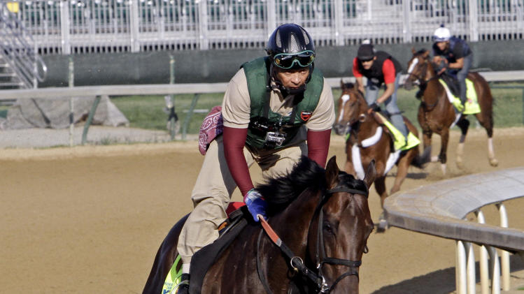 An exercise rider takes Kentucky Derby hopeful Itsmyluckyday for a workout at Churchill Downs Wednesday, May 1, 2013, in Louisville, Ky. (AP Photo/Garry Jones)