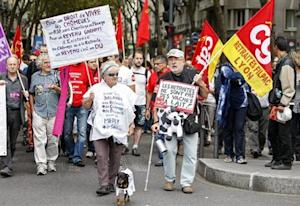 Private and public sector workers demonstrate over pension reforms in Lyon