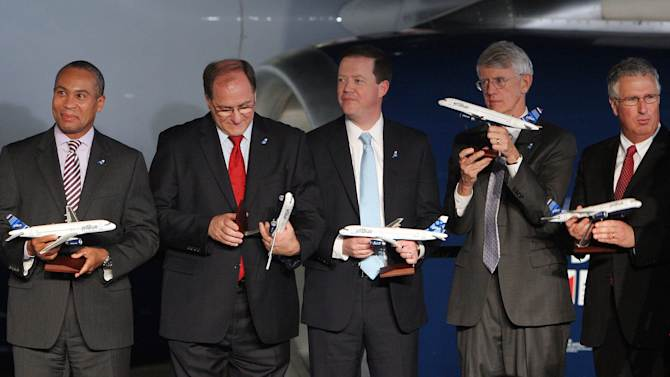 From left to right are Massachusetts Governor Deval Patrick, U.S. Congressman Michael Capuano, MassDOT Secretary and CEO Richard Davey, Massport CEO & Executive Director Thomas Glynn, and Massachusetts Senator Tom McGee.  All received model aircraft during a celebration of  jetBlue Airways' move to historic Hanger 8 at Logan International Airport in Boston, Massachusetts, Monday, Dec. 10, 2012.  (Aynsley Floyd/AP Images for jetBlue Airways)