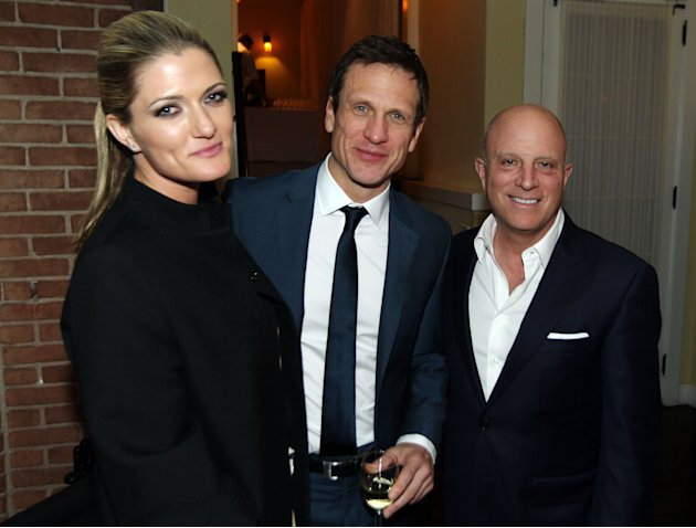 "Chris Albrecht, chief executive of STARZ, right, Simon Merrells, center, and Montana Coady Albrecht pose together at the after party for the premiere of ""Spartacus: War of the Damned"" on Tuesday, Jan."