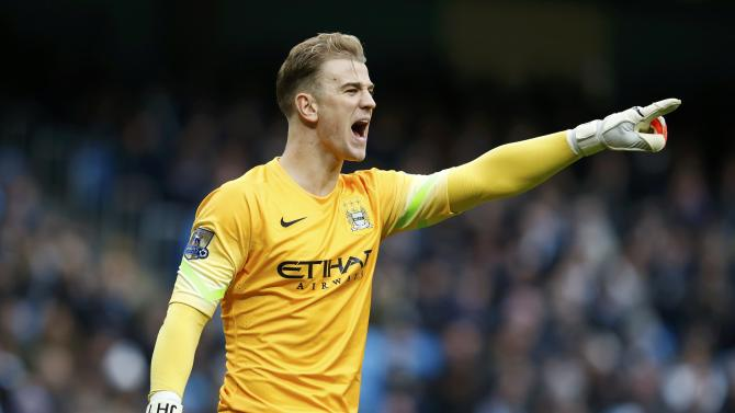 Manchester City's Joe Hart reacts during their English Premier League soccer match against Crystal Palace at the Etihad Stadium in Manchester