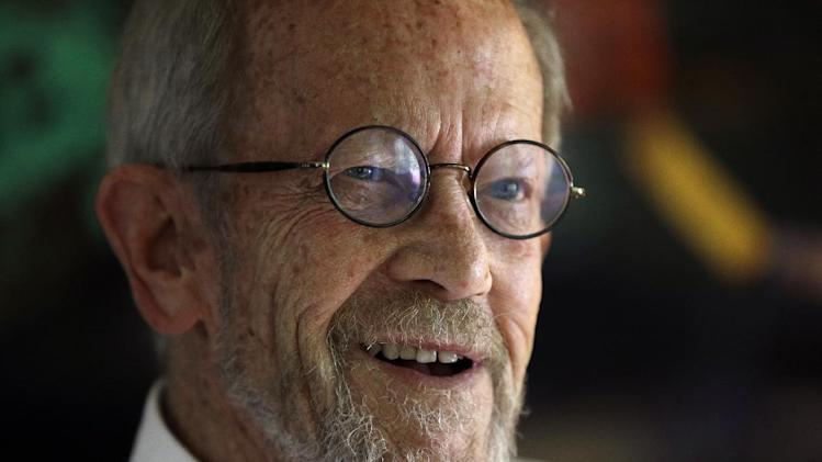 FILE - This Sept. 17, 2012 file photo shows author Elmore Leonard, 86, smiling during an interview at his Bloomfield Township, Mich., home. Leonard, winner this year of an honorary National Book Award, is 87 and says the prize inspired him to write more novels.  (AP Photo/Paul Sancya, file)