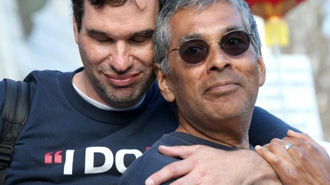 Scott Coatsworth (left) and Mark Guzman (right) embrace during a rally in support of marriage equality on March 26 in San Francisco.
