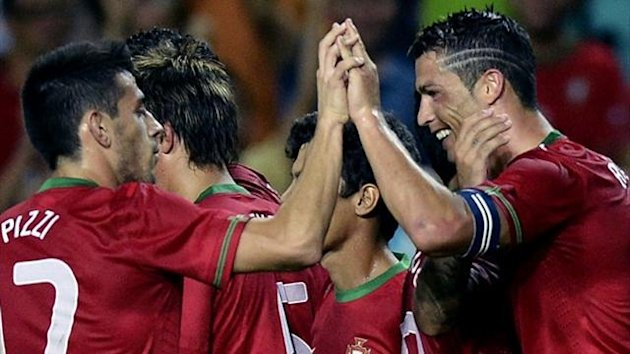 Portuguese forward Cristiano Ronaldo (R) celebrates after scoring the equaliser against the Netherlands in a friendly at Algarve Stadium (AFP)