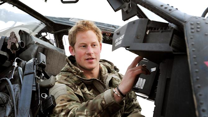 """FILE - In this Dec. 12, 2012, file photo Britain's Prince Harry makes his early morning pre-flight checks on the flight-line, from Camp Bastion southern Afghanistan. Palace officials say that Prince Harry is ending his role as a helicopter pilot and taking up a new job with the army in London. Kensington Palace said Harry — known in the army as Capt. Wales — will now be organizing """"major commemorative events"""" involving the army. (AP Photo/ John Stillwell, Pool)"""