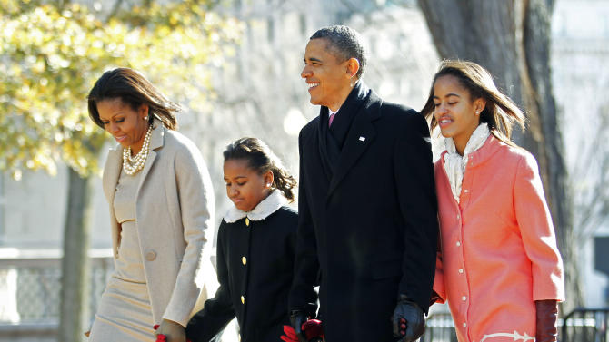 FILE - In this Dec. 11, 2011, file photo, file photo President Barack Obama, first lady Michelle Obama, left, and their daughters Sasha and Malia, right, walk from the White House in Washington to attend a Sunday service at nearby St. John's Church. Obama likes to talk about his kids. What parent doesn't? But he's the president, and he brings up his daughters to explain his thinking on all sorts of combustible national issues, from the rescue of an American aid worker from Somali pirates to the touchy subject of public access to emergency contraception. (AP Photo/Manuel Balce Ceneta, File)