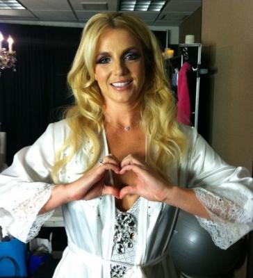 "Britney Spears seen making a heart shape for the ""Show Your Hearts"" campaign, July 2011 -- Facebook"
