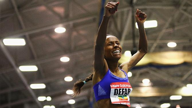 Meseret Defar of Ethiopia celebrates after winning the women's 3000m during on February 14, 2016 in Boston, Massachusetts