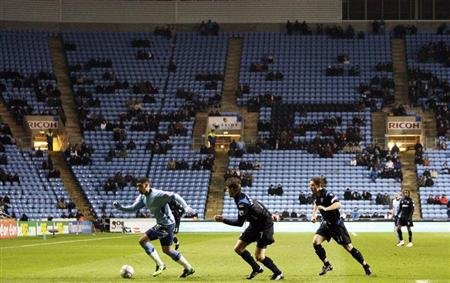 Coventry City play Portsmouth in front of a sparse crowd during their FA Cup soccer match in Coventry