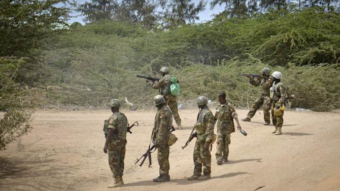 """In this photo provided by the African Union Mission to Somalia (AMISOM), African Union (AU) soldiers from Uganda fire at al-Shabab positions in their stronghold of Bulomarer in the Lower Shabelle region of Somalia Saturday, Aug. 30, 2014. Somali government troops fighting alongside AU troops drove the militants from the town as part of their military offensive dubbed """"Indian Ocean"""" aiming to oust al-Shabab from its last major hideouts in the southern parts of the Horn of Africa nation. (AP Photo/AMISOM, Tobin Jones)"""