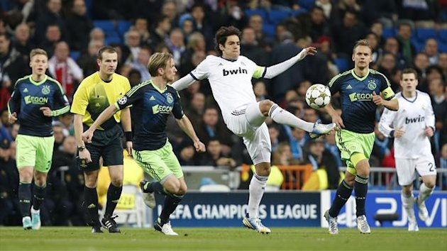 Real Madrid's Kaka fights for the ball with Ajax Amsterdam's Christian Poulsen during their Champions League Group D match