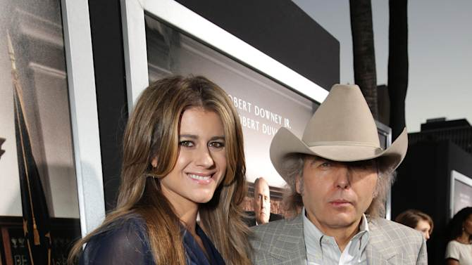 "Emily Joyce and Dwight Yoakam seen at Warner Bros. Picture's Los Angeles Premiere of ""The Judge"" held at Samuel Goldwyn Theatre, AMPAS on Wed, Oct 1, 2014, in Los Angeles. (Photo by Eric Charbonneau/Invision for Warner Bros./AP Images)"