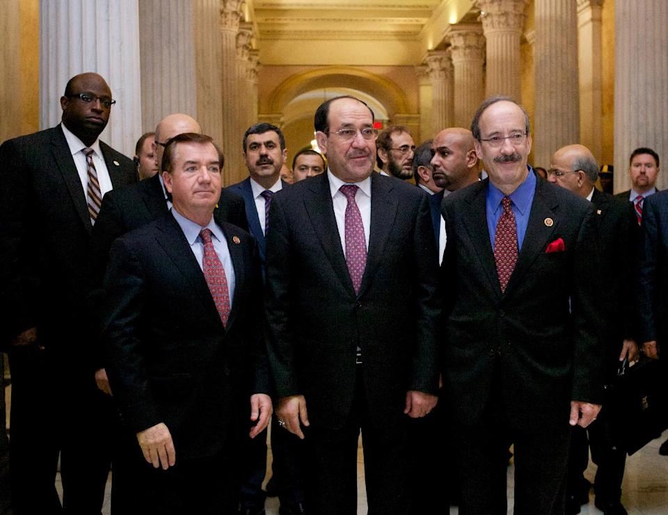 Iraq's Prime Minister Nouri al-Maliki, center, walks with the House Foreign Affairs Committee ranking Democrat Rep. Eliot Engel, D-N.Y., right, and the committee's chairman Rep. Ed Royce, R-Calif., on Capitol Hill in Washington, Wednesday, Oct. 30, 2013, before their meeting. Earlier, the prime minister met with Vice President Joe Biden. (AP Photo/Molly Riley)