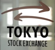 Japan's two biggest bourses said Thursday they have won regulatory approval for a planned merger in January amid stiff competition from overseas rivals