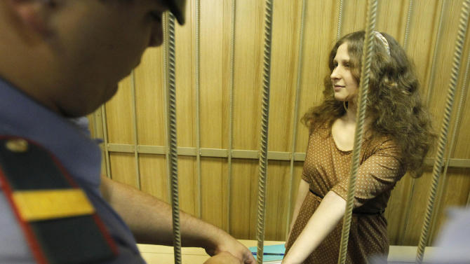 "Maria Alekhina, a member of the feminist punk band, Pussy Riot,  in a cage in a district court in Moscow, Wednesday, June 20, 2012. She and two other band members face up to seven years on hooliganism charges after their February ""punk prayer"" at Moscow's Christ the Savior Cathedral in which they asked Holy Mary to deliver Russia from President Vladimir Putin.(AP Photo/Misha Japaridze)"