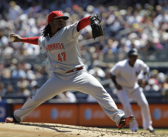 Cincinnati Reds starting pitcher Johnny Cueto delivers in the first inning against the New Yankees during an interleague baseball game at Yankee Stadium in New York, Sunday, May 20, 2012. (AP Photo/Kathy Willens)