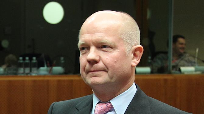 British Foreign Secretary William Hague waits prior to the start of the EU foreign ministers meeting at the European Council building in Brussels, Monday, Nov. 19, 2012. The European Union's foreign policy chief is expressing concern about the mounting death toll in the Gaza conflict, saying the crisis can only be resolved with a long-term solution. (AP Photo/Yves Logghe)