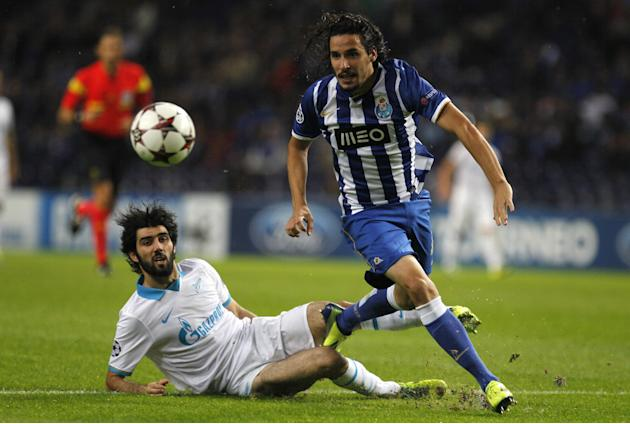 "Porto's Luis ""Lica"" Carneiro, right, vies for the ball with Zenit's Luis Neto, from Portugal, during the Champions League group G soccer match between FC Porto and Zenit at the Dragao stadium in Porto"