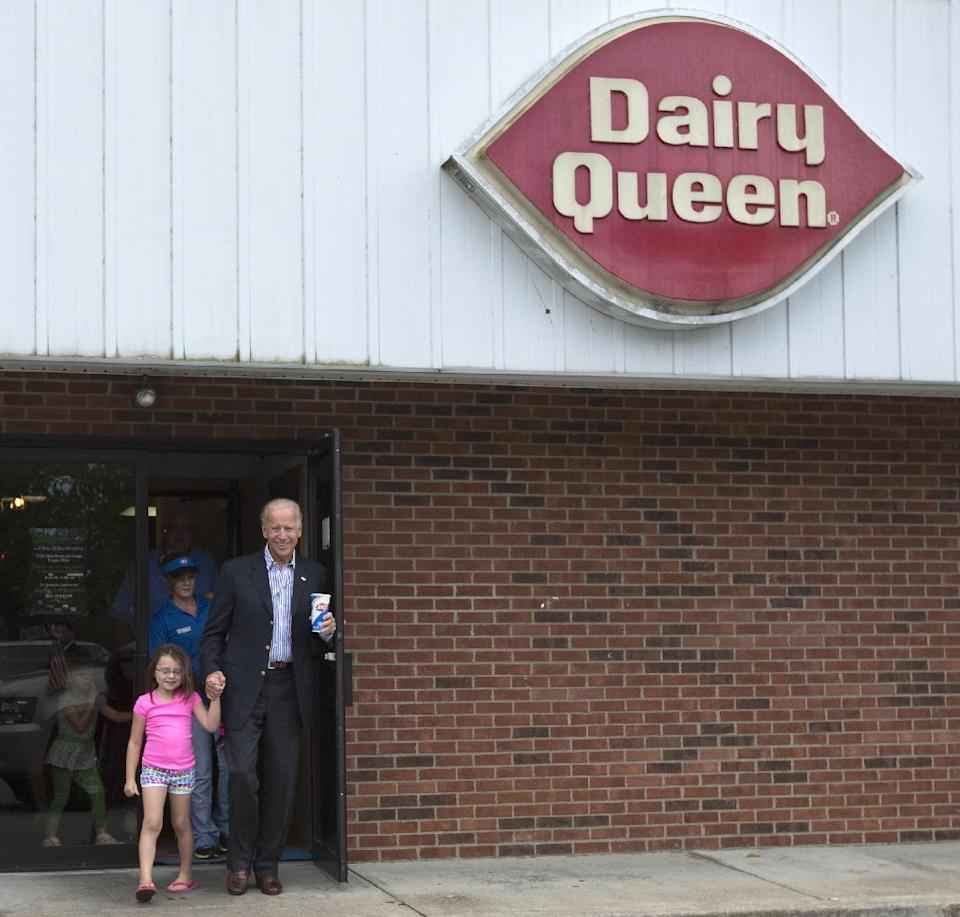 Vice President Joe Biden leaves Dairy Queen with an ice cream cone and holding the hands of a little girl, Saturday, Sept. 8, 2012, in Nelsonville, Ohio.  (AP Photo/Carolyn Kaster)
