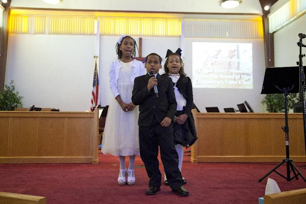 "Members of the children's voice class from left, Faith Harrell, George Hayson, and Sharolyn Hayson, sing ""Climb Every Mountain, from The Sound of Music, during the Alexandria School for the Performing"