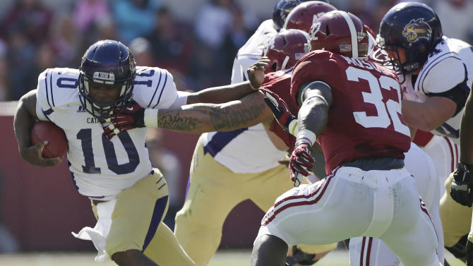 Western Carolina quarterback Troy Mitchell (10) tries to break away from the tackle of Alabama defensive lineman Jesse Williams (54) and linebacker C.J. Mosley (32) during the first half of an NCAA college football game at Bryant-Denny Stadium in Tuscaloosa, Ala., Saturday, Nov. 17, 2012. (AP Photo/Dave Martin)