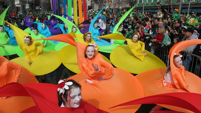 Dancers from Dublin's Atomic Stage School put on a colorful display during St. Patrick's Day parade in Dublin, Saturday, March 17, 2012. Police estimate a half-million spectators lined the route of the parade, the biggest of more than 50 across Ireland honoring the nation's patron saint. (AP Photo/Shawn Pogatchnik)