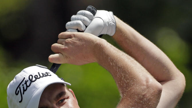 Marc Leishman, of Australia, tees off on the fourth hole during the second round of the Masters golf tournament Friday, April 12, 2013, in Augusta, Ga. (AP Photo/David Goldman)