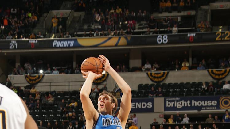 Ellis, Nowitzki help Mavericks top host Pacers