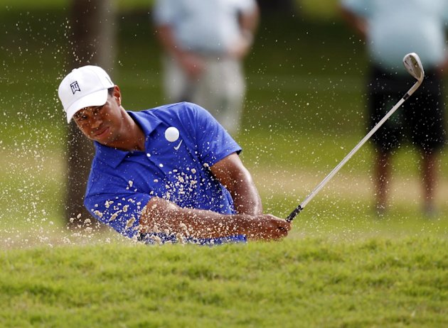 Tiger Woods hits from a second hole bunker during the second round of the Cadillac Championship golf tournament on Friday, March 9, 2012, in Doral, Fla. (AP Photo/Wilfredo Lee)