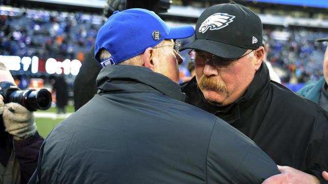 Philadelphia Eagles head coach Andy Reid, right, shakes hands with New York Giants head coach Tom Coughlin after an NFL football game, Sunday, Dec. 30, 2012, in East Rutherford, N.J. The Giants won 42-7. (AP Photo/Bill Kostroun)