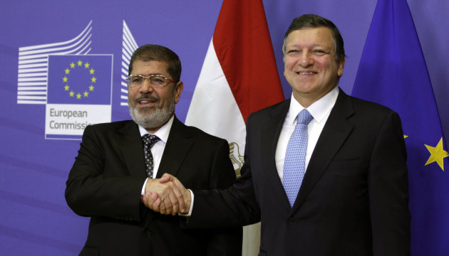 European Commission President Jose Manuel Barroso, right, greets Egyptian President Mohamed Morsi prior to a meeting at the EU headquarters in Brussels on Thursday, Sept. 13, 2012. (AP Photo/Virginia Mayo)