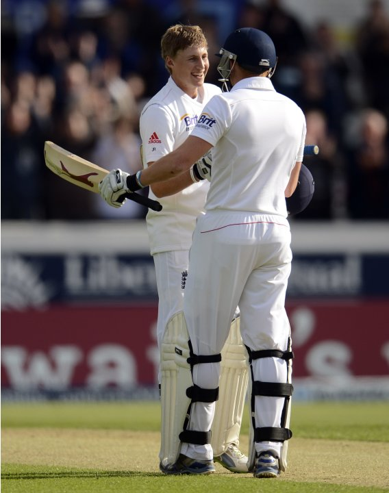 England's Root celebrates after reaching his first test century with Bairstow during the second test cricket match against New Zealand at Headingley cricket ground in Leeds
