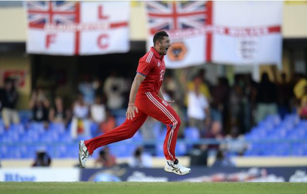 England's Bresnan celebrates after bowling West Indies' Ramdin as England won the third one-day international cricket match at North Sound