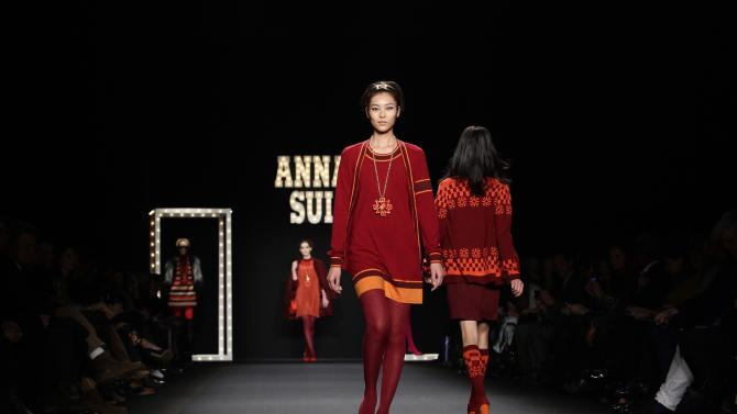 Models present creations from the Anna Sui Autumn/Winter 2013 collection during New York Fashion Week