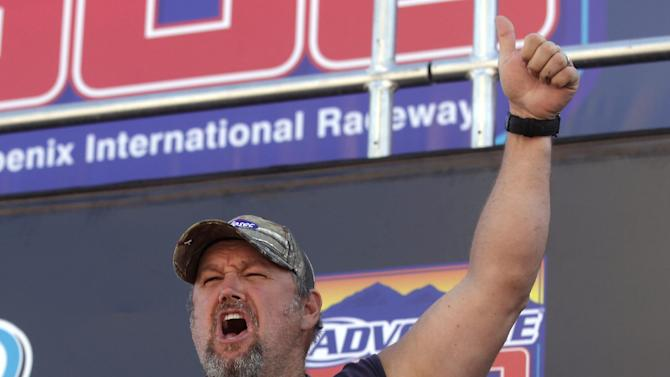 Frequent heartburn sufferer and comedian, Larry the Cable Guy goofs off at the Phoenix International Raceway before the race to promote new Prilosec OTC Wildberry and encourage fans to enter the Wild American Flavor Sweepstakes at www.WildberryFlavor.com on Sunday, Nov. 11, 2012, in Avondale, Ariz.(AP Photo/Rick Scuteri)
