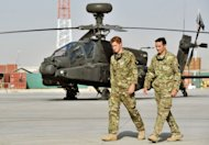 Prince Harry (2nd right) walks past an Apache helicopter upon his arrival at Camp Bastion in Afghanistan. Harry is back in Afghanistan to serve as a military helicopter pilot four years after his previous deployment there had to be cut short