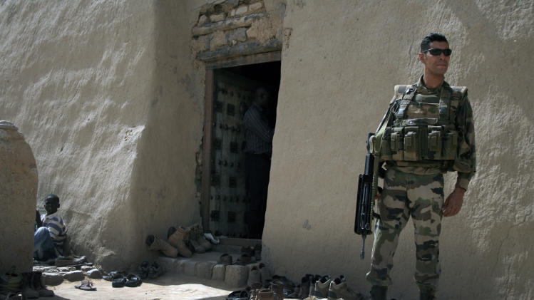 A French soldiers  stands guard outside Djigarey Ber mosque during friday prayers in Timbuktu, Mali, Friday Feb. 1, 2013. French President Francois Hollande is scheduled to visit the fabled city Saturday. (AP Photo/Harouna Traore)