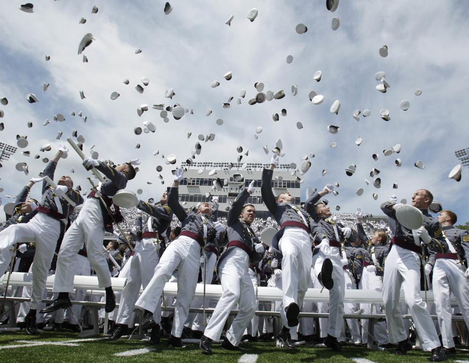 Cadets toss their hats in the air at the conclusion of a graduation and commissioning ceremony at the U.S. Military Academy in West Point, N.Y., on Saturday, May 21, 2011.   (AP Photo/Mike Groll)
