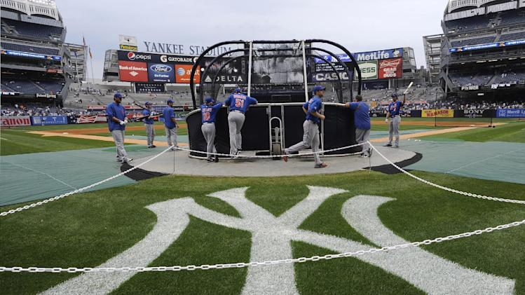 The New York Mets take batting practice before an interleague baseball game against the New York Yankees, Saturday, June 9, 2012, at Yankee Stadium in New York. (AP Photo/Kathy Kmonicek)