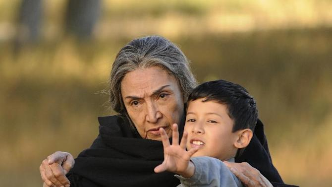 """This film image released by Arenas Entertainment shows Luke Ganalon, right, and Miriam Colon in a scene from """"Bless Me, Ultima."""" (AP Photo/Arenas Entertainment)"""