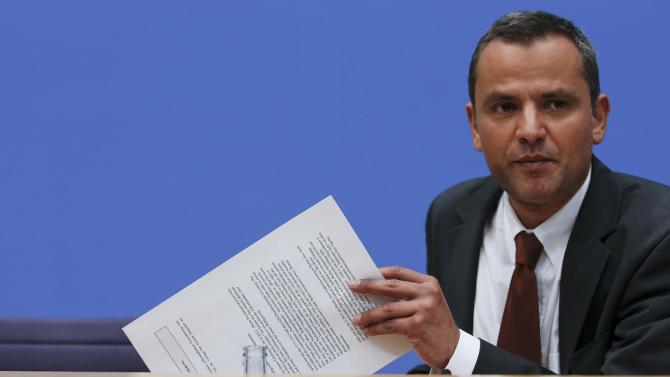 Edathy of the Social Democratic Party (SPD) and former member of lower house of parliament Bundestag holds papers during a news conference in Berlin