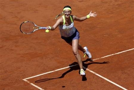 Victoria Azarenka of Belarus hits a return to Serena Williams of the U.S. during their women's singles final match at the Rome Masters tennis tournament May 19, 2013.