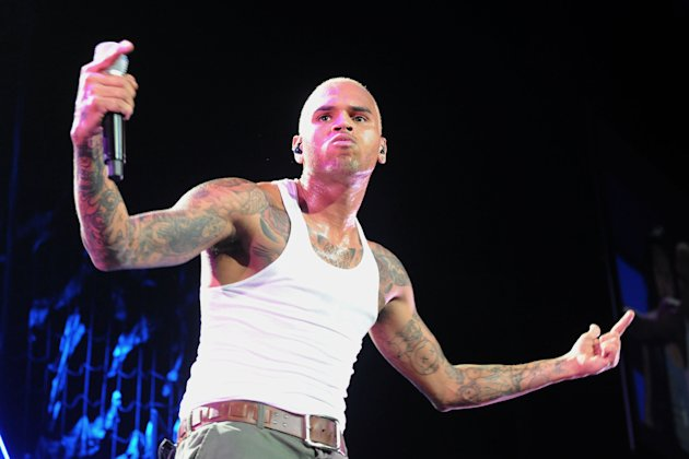 FILE - This Oct. 20, 2011 file photo shows Chris Brown performs live as part of the F.A.M.E Tour at The Staples Center in Los Angeles. Brown is under investigation for an alleged assault in a West Hollywood parking lot, the Los Angeles County Sheriff's Department said early Monday, Jan. 28, 2013. Deputies responding to a report of six men fighting Sunday night found the scene clear, but were told by witnesses that there had been a brief fight over a parking space. (AP Photo/Katy Winn, file)