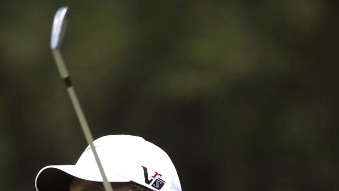 Tiger Woods of the United States watches his shot on the 8th hole during round three of CIMB Classic golf tournament at the Mines Resort and Golf Club in Kuala Lumpur, Malaysia, Saturday, Oct. 27, 2012.  (AP Photo/Vincent Thian)