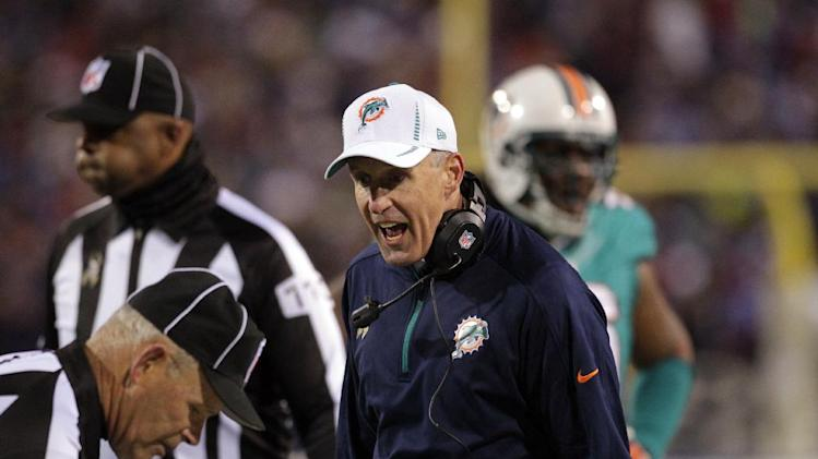 Miami Dolphins head coach Joe Philbin talks to a referee during the first half of an NFL football game against the Buffalo Bills, Thursday, Nov. 15, 2012, in Orchard Park, N.Y. (AP Photo/Bill Wippert)