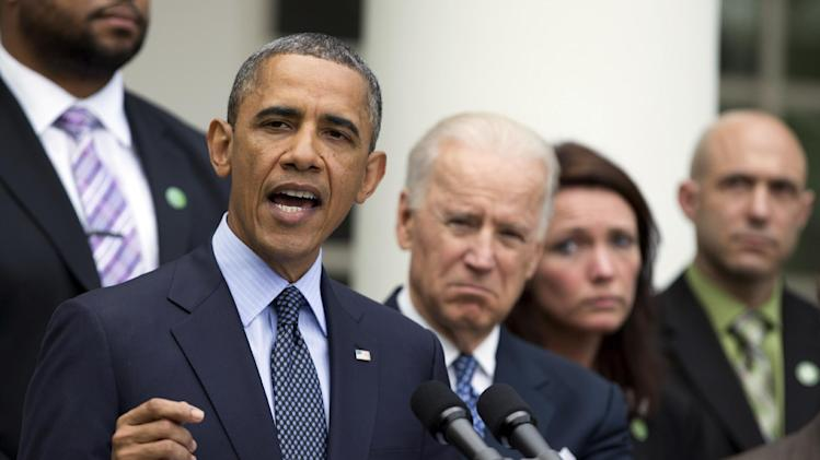 President Barack Obama, from left, with Vice President Joe Biden, speaks about measures to reduce gun violence, in the Rose Garden of the White House in Washington, Wednesday, April 17, 2013, as Nicole Hockley and Jeremy Richman, watch. (AP Photo/Manuel Balce Ceneta)